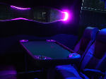 Chauffeur driven Party Bus limo hire Poker den interior in Bristol, Gloucester, Cheltenham, Cardiff, Wales, Weston Super Mare, and Bath.