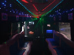 Chauffeur driven Pink Panther Party Bus limo hire interior in Birmingham, Coventry, Dudley, Wolverhampton, Telford, Worcester, Walsall, Stafford, Midlands