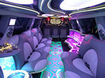 Chauffeur stretched pink Hummer H2 limousine hire interior in UK